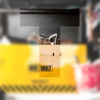 Blurred image of a tool kit with a transparent T overlayed