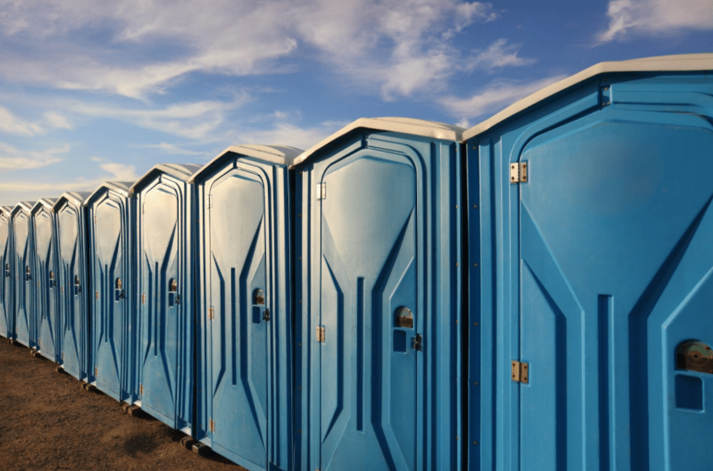 Row of blue portable toilets